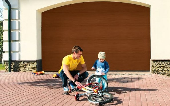 Child playing in front of garage door on driveway