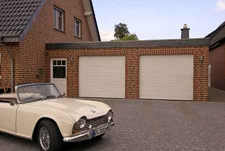 Gliderol roller shutter garage door with classic car on driveway