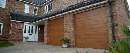 Gliderol Tuscan sectional door finished in Golden Oak laminate