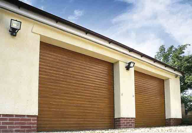 double garage fitted with 2 x seceuroglide roller shutter doors finished in golden oak laminated wood double door46 double