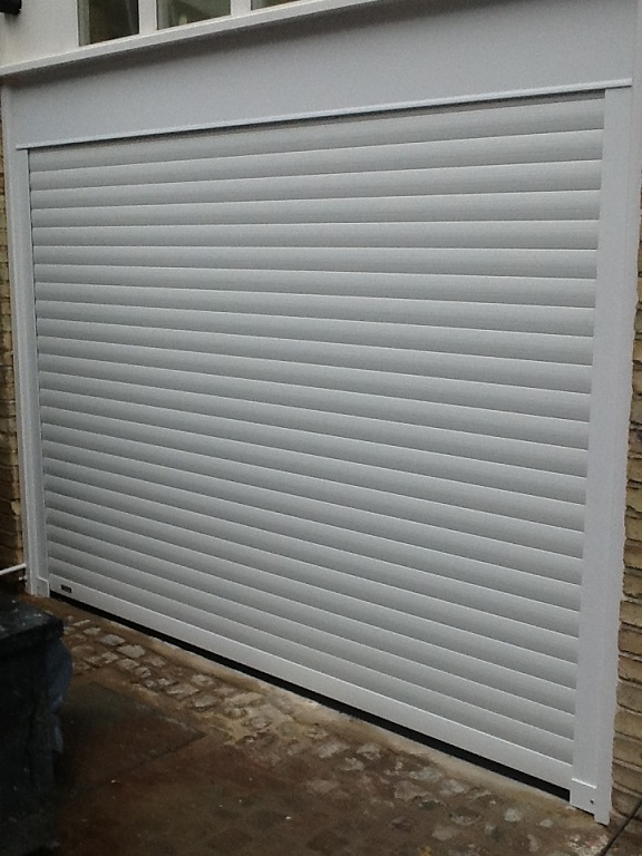 Seceuroglide roller garage door installed between the reveal