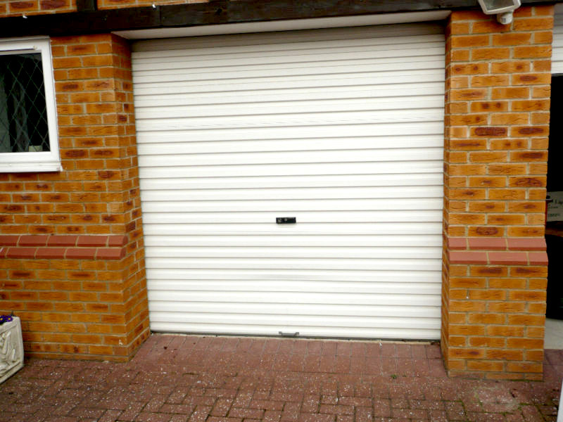 White single skin Gliderol garage roller door fitted to residential garage attached to house