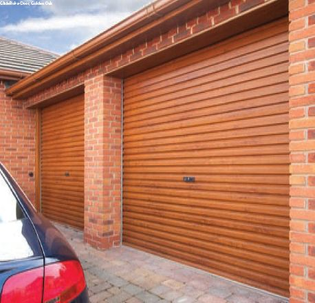 Example of a golden oak laminated wood effect garage door fitted to a double brick built garage