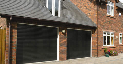 Double garage fitted with black insulated roller shutter garage doors