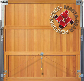 Solid built wooden garage door showing inside face and lifting gear fitted