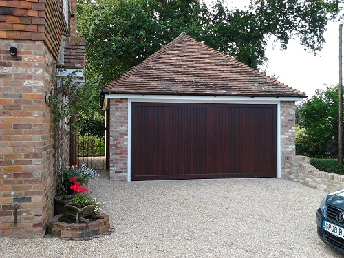 Woodrite Buckingham wooden garage door fitted to a brick built garage with a white door frame