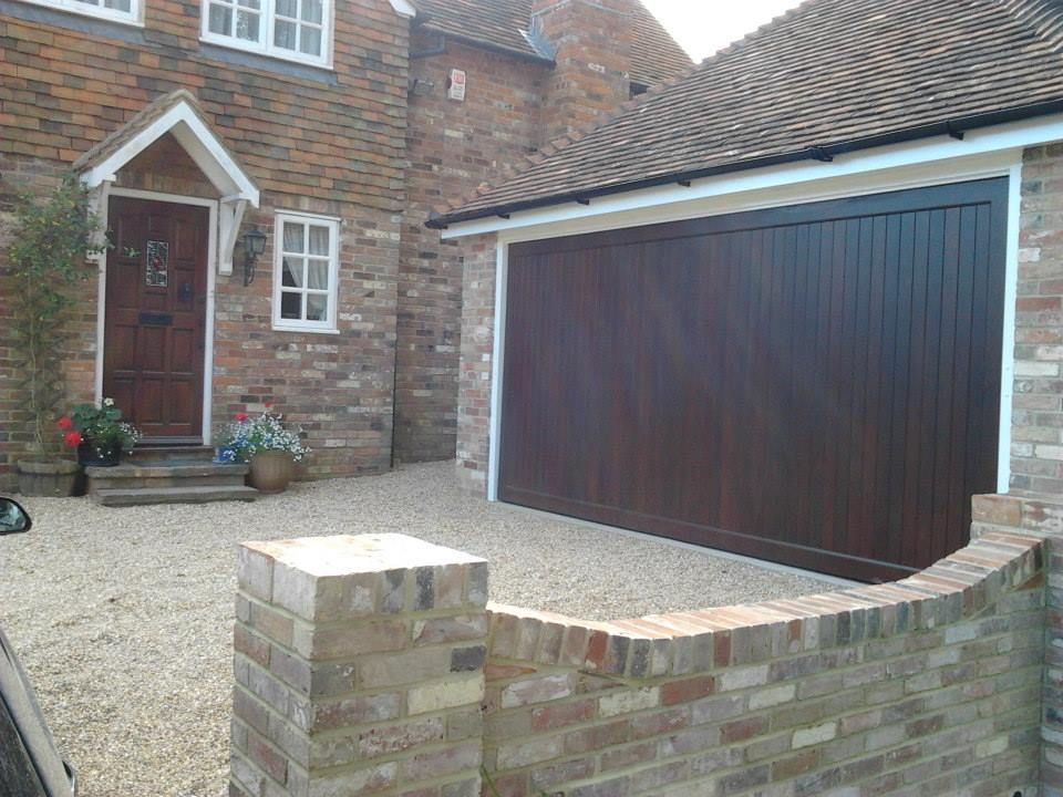 Woodrite Chalfont up and over timber garage door fitted to a brick built garage with clay tiled roof